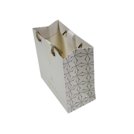 Shopping gold paper gift bag with logo design